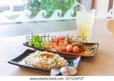 Noodle with dired Yong Tau Foo and chrysanthemum water side big window - stock photo