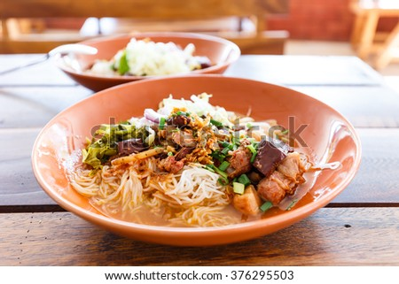 Noodle with spicy pork sup, traditional northern Thai food - stock photo