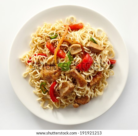 noodles with chicken and vegetables on white plate isolated on white - stock photo