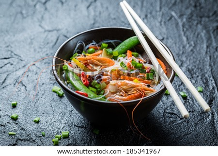 Noodles with vegetables and prawns - stock photo