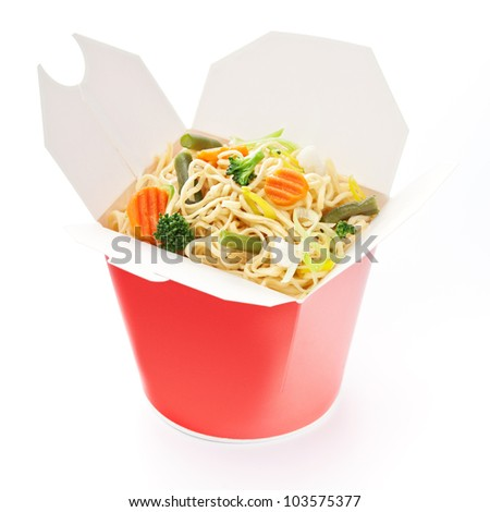 Noodles with vegetables in take-out box on white background - stock photo