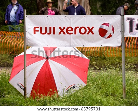NOOJEE - NOVEMBER 13: Sponsors logo umbrella and safety fence at one of the forest stages of Rally Victoria, November 13 2010, Noojee, Victoria, Australia. - stock photo