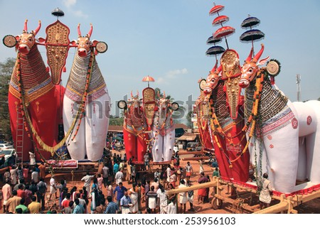NOORANAD, INDIA - FEB 18: Devotees look at the massive bullock effigies displayed during the Shivratrhri festival at Padanilam Parabrahma temple on February 18,2015 in Nooranad,Kerala, India - stock photo