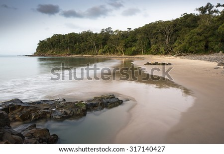 Noosa Heads Stunning Tropical Coastline Landscape With a Glassy Shore and Rich Green Vegetation in Summer During Sunset, Little Cove, Sunshine Coast, Queensland, Australia - stock photo
