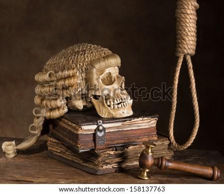 Noose and judge's wig symbolizing death sentence - stock photo