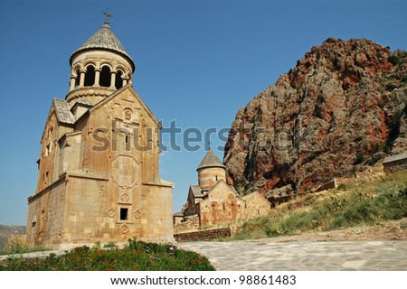 Noravank medieval monastery in Armenia, red rocks in the background - stock photo