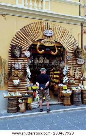 NORCIA PERUGIA UMBRIA,  ITALY, AUGUST 23 -typical and picturesque norcineria shop where they sell meat, sausage, cheese and other food products in the area,  August 23 2014, norcia, umbria italy - stock photo