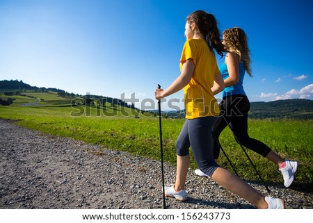 Nordic walking - active people outdoor - stock photo