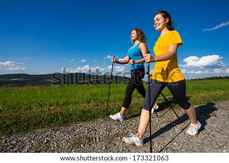 Nordic walking - active people outdoor  - stock photo