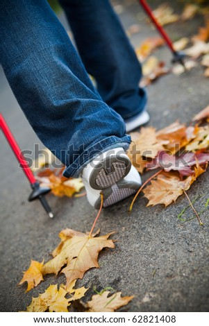 Nordic walking race on autumn trail - stock photo
