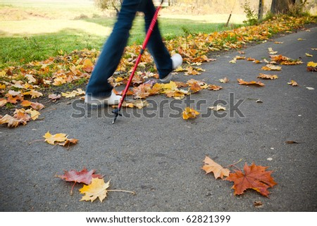 Nordic walking race on autumn trail - motion blur - stock photo