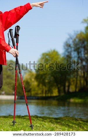 Nordic walking. Sticks in the park. Hand showing pointing at blank on the sky. Active healthy lifestyle. - stock photo