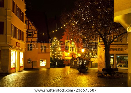 NORDLINGEN, GERMANY - DECEMBER 22, 2012: Beautiful view by night of the historic town of Nordlingen, Bavaria, Germany - stock photo