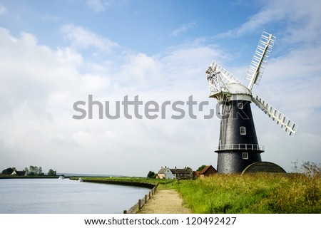 Norfolk Broads black and white windmill on a summer day landscape - stock photo
