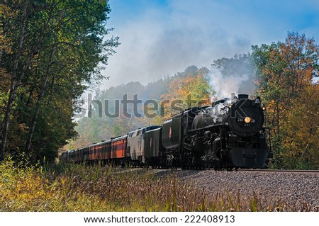 NORMAN MN - SEPTEMBER 27: Fall colors excursion of the Milwaukee Road #261 Steam Engine from Minneapolis, MN to Duluth, MN. Train steams through fall color corridor on September 27 2014 near Norman MN - stock photo