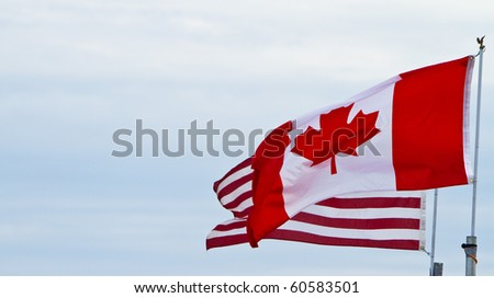 North American flags on a windy day - stock photo