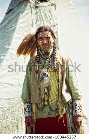 North American Indian in full dress. Reconstruction - stock photo