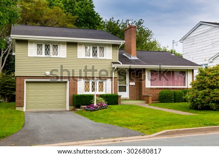 North American split level house from the seventies or eighties. - stock photo