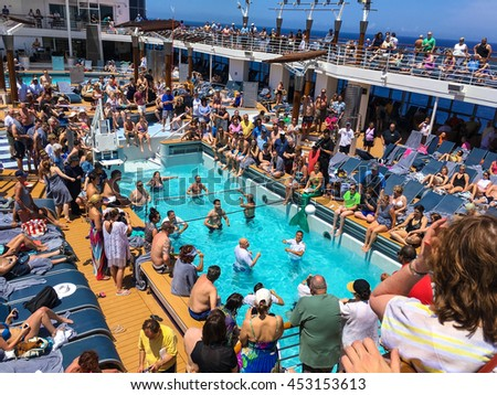 NORTH ATLANTIC, OCEAN - MAY 24 - The ship officers verses the passengers in a pool volleyball came onboard the Celebrity Summit on May 24 2016 in route to Bermuda. - stock photo