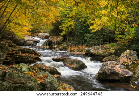 North Carolina Autumn Cullasaja River Scenic Landscape near Highlands NC in western North Carolina outdoors during the fall foliage - stock photo