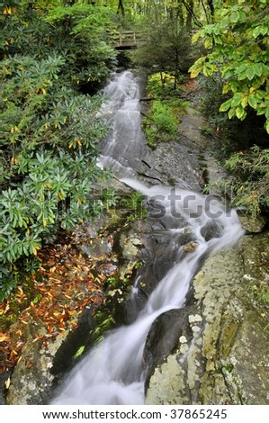 North Carolina Blue Ridge Parkway Cascade Waterfall in Autumn Vertical - stock photo