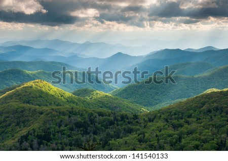 North Carolina Great Smoky Mountain Scenic Landscape with Light Rays and Spring Greens - stock photo