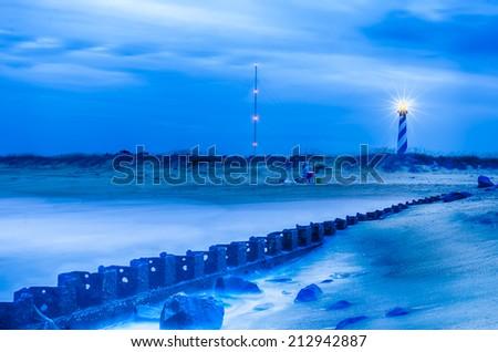 North Carolina OBX Retired Coastal Groyne Buxton Jetties on Old Lighthouse Beach - stock photo
