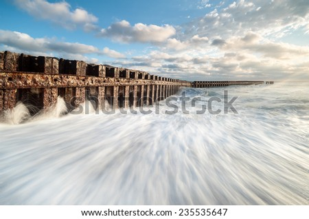 North Carolina Outer Banks Old Lighthouse Beach Buxton Jetty Hard Steel Erosion Control Structure - stock photo