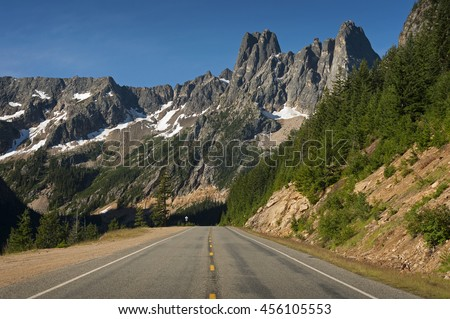 North Cascades Highway. The North Cascades Highway is the first National Scenic Highway in the United States. There are sweeping vistas, alpine meadows, wildlife watching and recreation galore. - stock photo