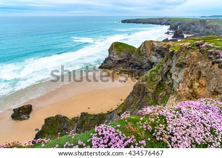 North Cornwall Coast. Pendarves Head and Island, with the Bedruthan Steps beach beyond.  Taken from Carnewas Point with Whitesone Cove in the foreground. - stock photo