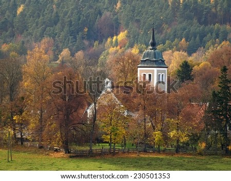 North East Poland landscape with small church in village - stock photo
