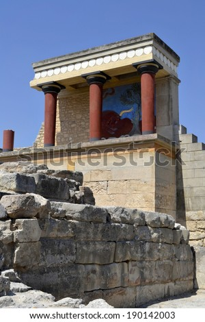 North Entrancein Knossos Palace  with charging bull fresco (15th century BC) . Knossos in Crete,  is one of the main centers of the Minoan civilization. - stock photo