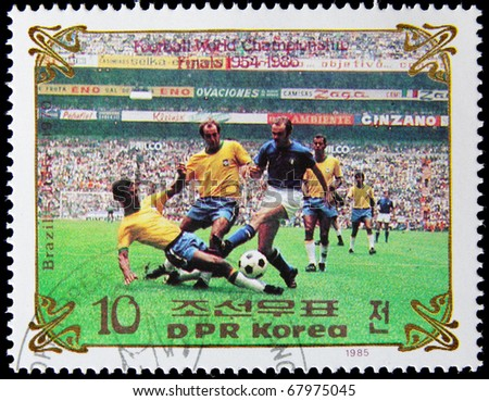 NORTH KOREA - CIRCA 1985:  A post stamp printed in North Korea, shows football players, devoted football world championship, series, circa 1985. - stock photo
