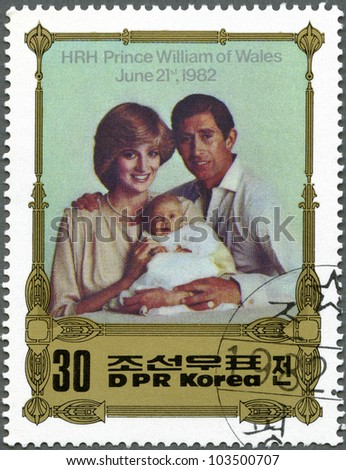 NORTH KOREA - CIRCA 1982: A stamp printed in DPR Korea shows Charles carrying William, with Diana, Birth of Prince William of Wales, circa 1982 - stock photo
