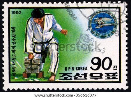 NORTH KOREA - CIRCA 1992: A stamp printed in DPR Korea shows Taekwon- World Championship, Sport series, circa 1992 - stock photo
