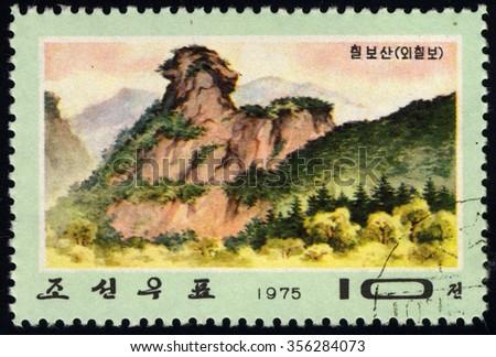 NORTH KOREA - CIRCA 1975: A stamp printed in North Korea dedicated to Chilbo Mountains shows Mae Rock, circa 1975 - stock photo