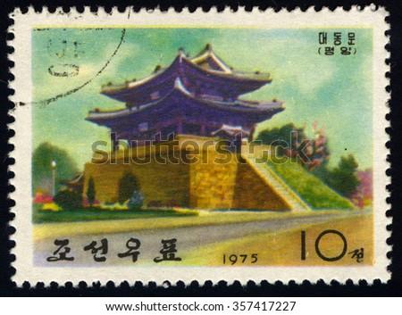 NORTH KOREA - CIRCA 1975: A stamp printed in North Korea dedicated to Potong Gate shows Ancient Wall-Gates of Pyongyang, circa 1975 - stock photo