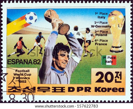 "NORTH KOREA - CIRCA 1982: A stamp printed in North Korea from the ""ESPANA 1982 World Soccer Cup Winners "" issue shows Italian goalkeeper Dino Zoff holding World Cup aloft, circa 1982. - stock photo"