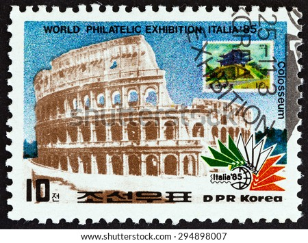 "NORTH KOREA - CIRCA 1985: A stamp printed in North Korea from the ""Italia 85 International Stamp Exhibition, Rome "" issue shows Colosseum, Rome, and N. Korea 1975 stamp, circa 1985. - stock photo"