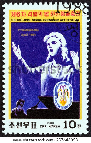 """NORTH KOREA - CIRCA 1988: A stamp printed in North Korea from the """"6th Spring Friendship Art Festival, Pyongyang """" issue shows singer (poster), circa 1988.  - stock photo"""
