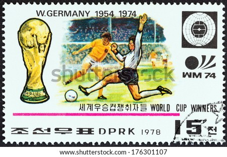 "NORTH KOREA - CIRCA 1978: A stamp printed in North Korea from the ""World Cup Football Championship Winners "" issue shows West Germany, 1954, 1974, circa 1978.  - stock photo"