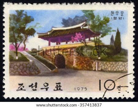 NORTH KOREA - CIRCA 1975: A stamp printed in North Korea to commemorate Hyonmu Gate show Ancient Wall-Gates of Pyongyang, circa 1975 - stock photo