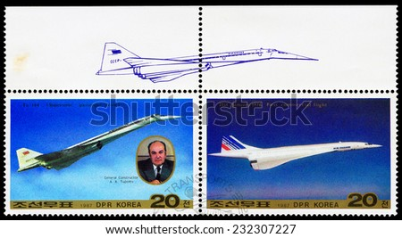 NORTH KOREA - CIRCA 1987: A stamps printed in North Korea shows airplane Tu-144 and General Designer Tupolev and first commercial flight, circa 1987 - stock photo