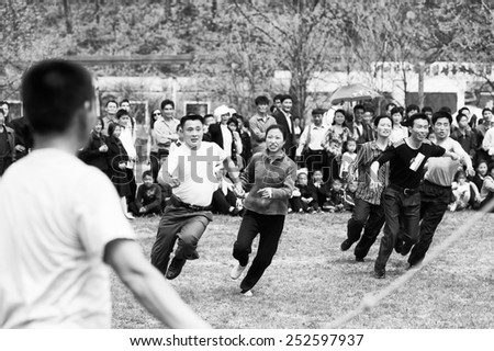 NORTH KOREA - MAY 1, 2012: Korean people jump over a skipping rope during the celebration of the International Worker's Day in N.Korea, May 1, 2012. May 1 is a national holiday in 80 countries - stock photo