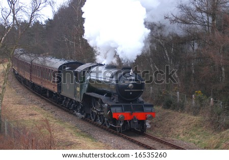 North Norfolk Railway approaching Holt. V2 Green Arrow. - stock photo