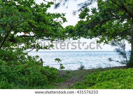 North Shore Oahu Hawaii at Kahana Bay beautiful green lush park by the ocean. - stock photo