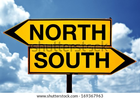North versus south, opposite direction signs - stock photo