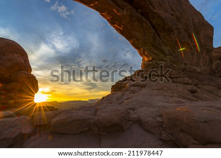 North Window light up by the rising sun Arches National Park  - stock photo
