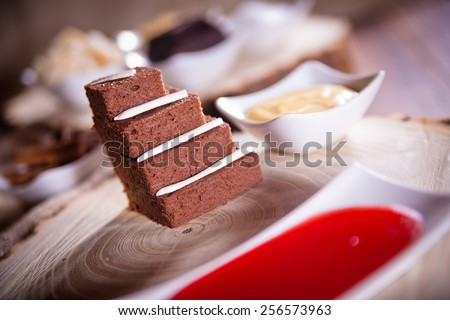 northern italy chocolate ricotta and grappa cake with cream and fruits jam (shallow depth of field) - stock photo