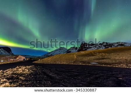 Northern Light Aurora borealis at Vik Iceland - stock photo